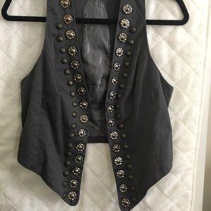Tops - Studded vest.